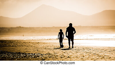 Father and son - Silhouette of father and son on the beach