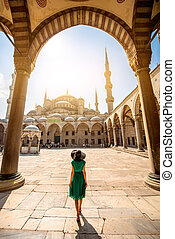 Woman near the Blue Mosque in Istanbul - Young woman...