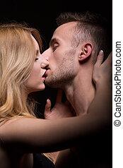 Portrait of a kissing couple - Close-up portrait of a beauty...