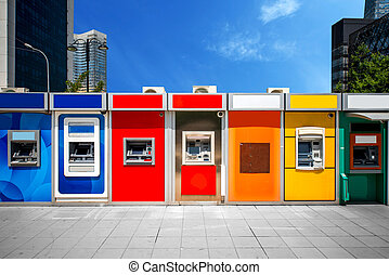 Cashpoint with colorful bankomats in the modern city