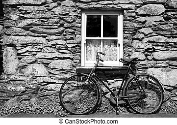 bicycle outside a rural old cottage in ireland - photo...