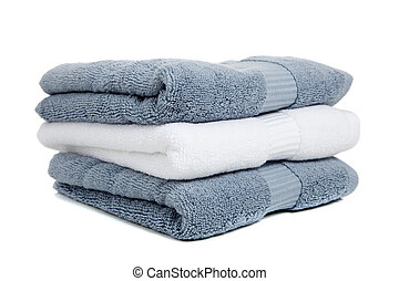 Gray blue and white towels with a bar of soap on white