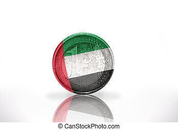 euro coin with united arab emirates flag on the white...