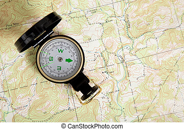 compass on a topographical map - A compass on a...