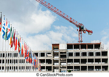 All European Countries flags with construction building crane in background