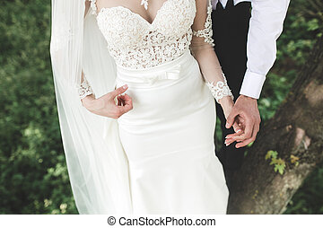 Bride and groom in the park - beautiful couple spends a fun...