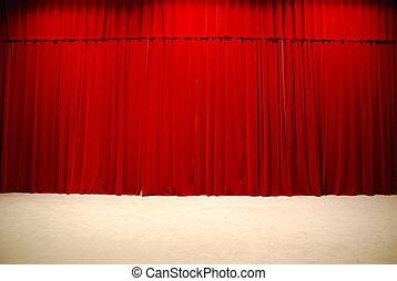 Red draped theater stage curtains