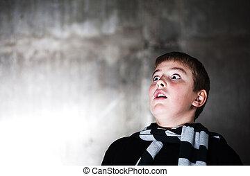 scarry teenaiger looking up at something big - photo taken...