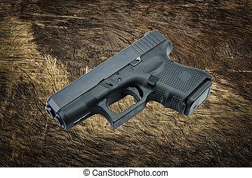 automatic 9mm. handgun pistol on ba