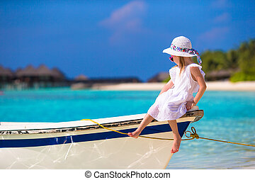 Adorable happy smiling little girl on boat in the sea - Cute...