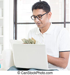 Earning from online business - Indian guy counting cash,...