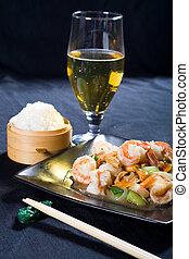 chinese prawn dish and wine