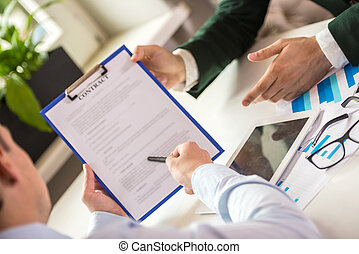 Business meeting - Close-up of male hands holding tablet and...