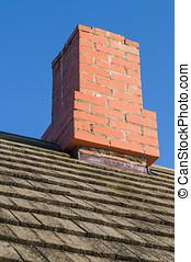Redbrick chimney and vintage wooden plank roof