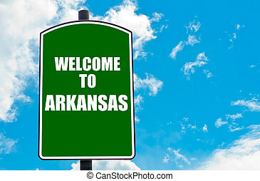 Welcome to ARKANSAS - Green road sign with greeting message...
