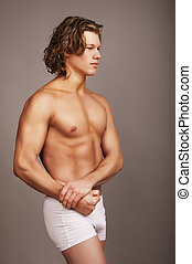 Portrait of mid adult man in briefs - Portrait of mid in...