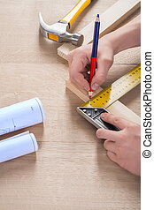 joiner do scetch on wooden plank