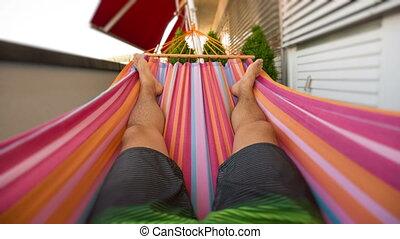 Seamless loop of a man in hammock