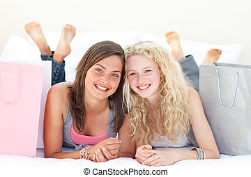 Portrait of two teen girls after shopping clothes - Portrait...