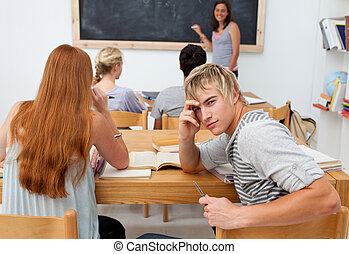Teenagers studying together in a class