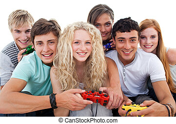 Portrait of teenagers playing video games in the living-room...