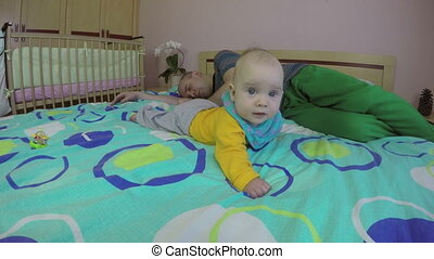 tired daddy and kid play - young sleeping tired father and...
