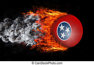 Flag with a trail of fire and smoke - Tennessee - Concept of...