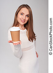 Woman giving paper cup - Smiling young woman giving offering...