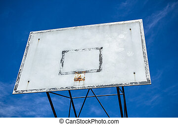 Basketball hoop broken - An old basketball hoop consumed by...