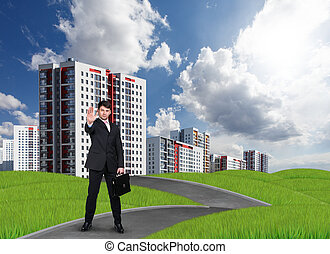 New high-rise buildings and man at the park