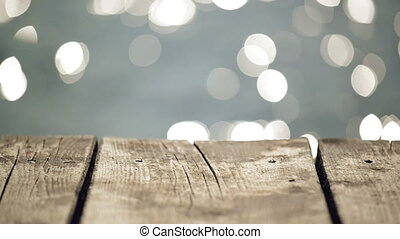 Old Wooden Pier Jetty on River with Water Sparkling in Bokeh...