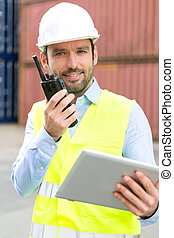 Young Attractive docker using tablet at work - View of an...