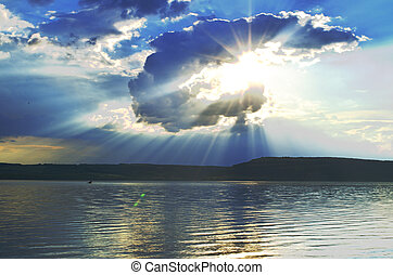 Sun shines through the cloud