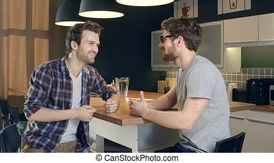 Man-to-Man Talk - Close up of two handsome guys talking in...