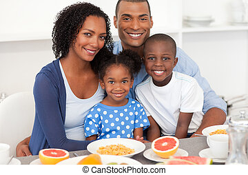 Happy family having healthy breakfast - Happy Afro-american...