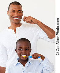 Father and his son brushing their teeth in the bathroom