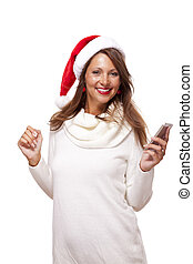 Pretty woman in a Santa hat reading an sms - Pretty woman in...