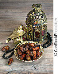 Dates, arabic lamps and rosary Islamic holidays concept...