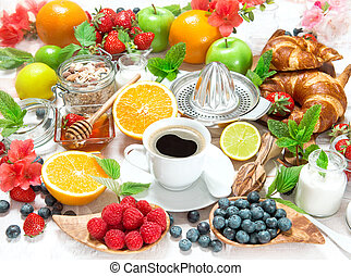 Breakfast with coffee, croissants ang fruits. Healthy food -...