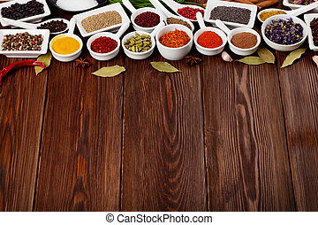 Various spices on wooden background. Top view with copy...
