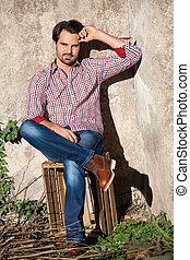 Male model sitting with legs crossed - Smiling male model...