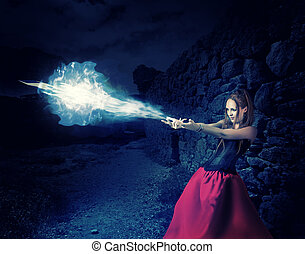 woman witch cast magic - cold ball of ice - beautiful woman...