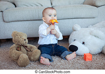 Playful baby boy with toys