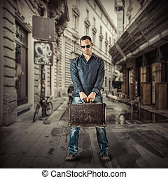 Young man traveller in street of european city
