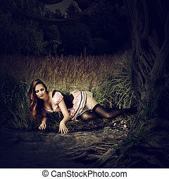 Beautiful sexy woman lie in dark forest - Beautiful sexy...