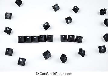 Thank you words composed with black letters of computer...