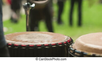 Playing on the drum