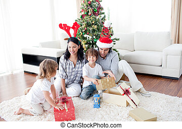 Cheerful family decorating a Christ