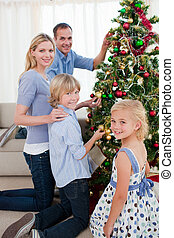 Joyful family celebrating christmas