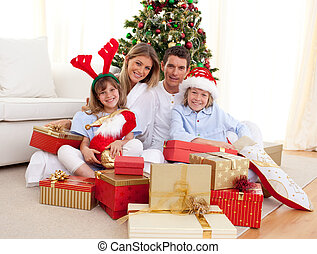 Pretty family unpacking presents wi